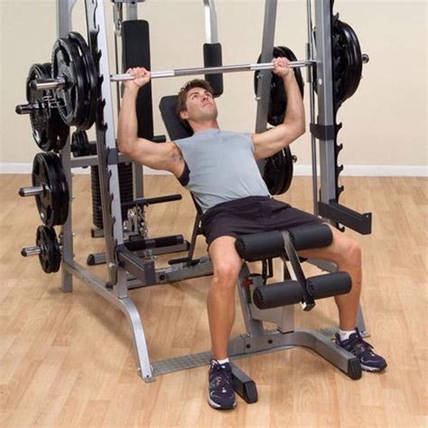 using smith machine for bench press body solid series 7 smith machine package system gs348qp4
