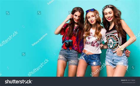 best for 3 three best friends posing studio wearing stock photo