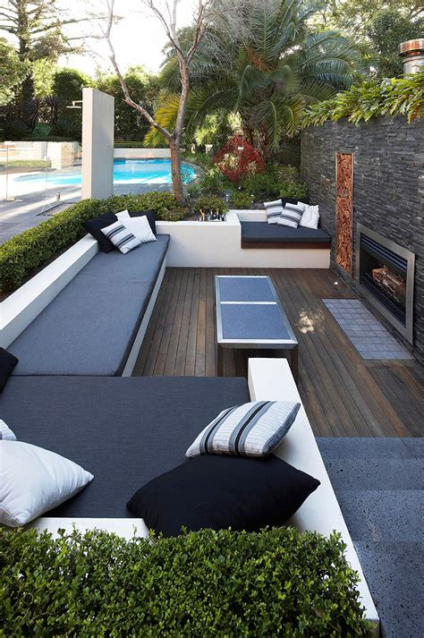 backyard lounge outdoor living with sunken lounge hedged monochrome soft