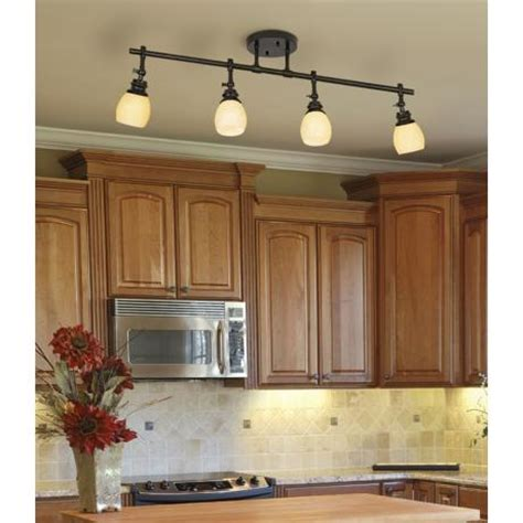 Light Bulbs For Kitchen Replace Fluorescent Light In Kitchen With Track Lighting And Add Small Lights The Cabinets