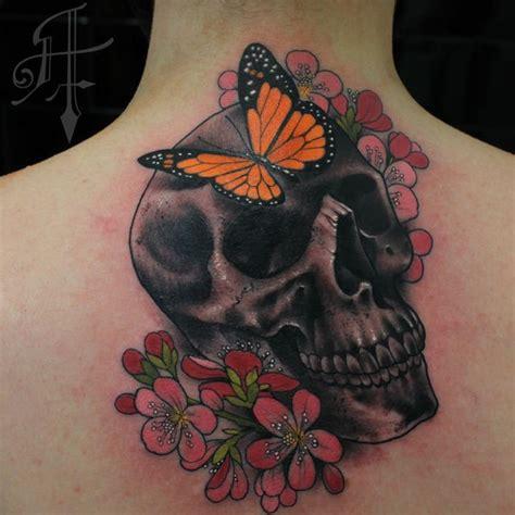 new school butterfly tattoo new school style colored upper back tattoo of human skull