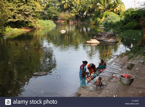 stock photos stock images alamy washing clothes in a river tenkasi tamil nadu