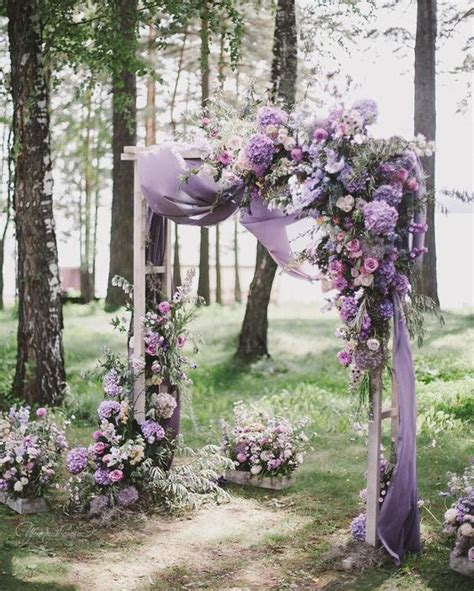 wedding arch purple picture of a fantastic floral arch with lilac draperies