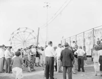 """""""crowds of people at the shenandoah county fair, with a"""