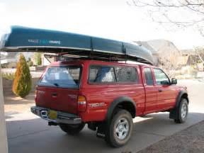 canoe on truck w cap thule tracker ii roof rack system