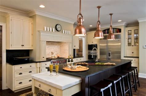 copper pendant lights above the kitchen island for a touch