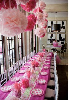 hanging pom poms from ceiling paper pom poms pink paper and pink on