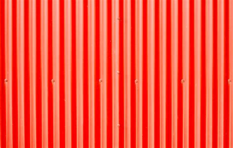 A Framed Houses by Red Corrugated Metal Photograph By Tom Gowanlock