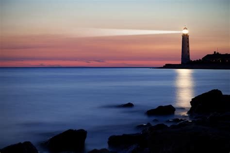 beacon of light meaning lighthouse over the horizon mortgageorb