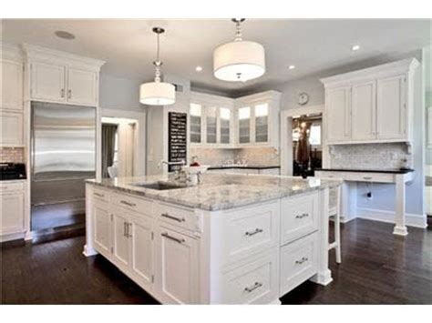 white kitchen cabinets marble island hardwood