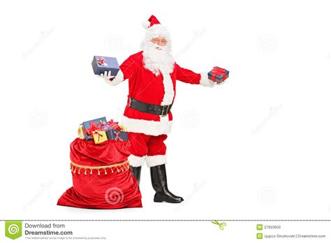 santa claus giving gifts and bag full of presents stock