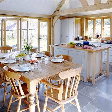 country homes and interiors uk airy open plan kitchen space with farmhouse furniture