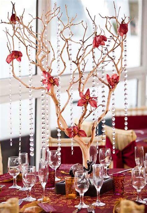 tall branch wedding centerpiece with hanging crystalswedwebtalks wedwebtalks