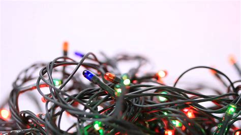 tangled christmas light bulbs on white background stock