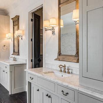restoration hardware bathroom mirror long bathroom with wood and marble floors cottage bathroom