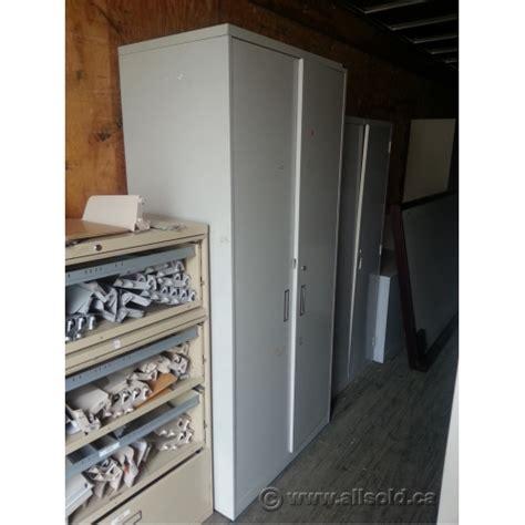 Metal 2 Door Storage Cabinet Rgo Beige 2 Door Metal Storage Cabinet W Hanger Bar Locking Allsold Ca Buy Sell Used