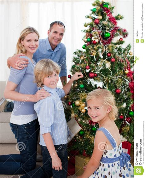 family christmas tree jarrettsville smiling family decorating a tree royalty free stock photography cartoondealer