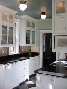 kitchen white cabinets black countertops interior