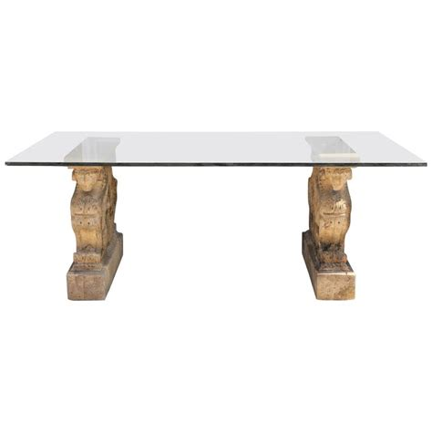 winged griffin cast pedestal dining table with glass
