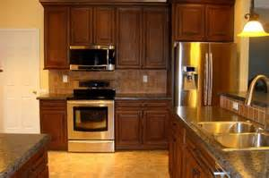 cherry cabinets with black glaze tile backsplash hd