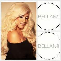 beach blonde bella mi extensions clip in bellami hair extentions made into a ponytail
