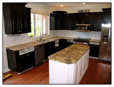 white and black kitchen island with cherner counter stools villa roma granite countertops in kitchen expresso