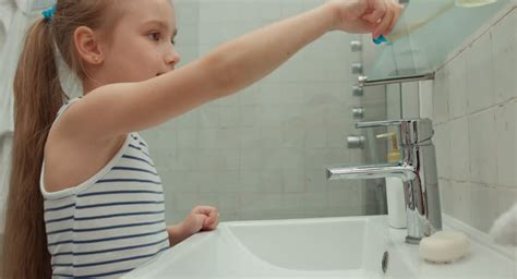 soap two girls and one boy boy washing in seven step with smiling stock footage 11837105