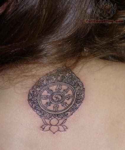 small round tattoos small tibetan symbol on back
