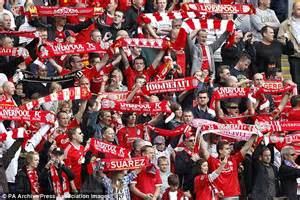 Manchester United Fans manchester united fan with an away scarf in the kop at
