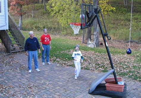 backyard basketball hoops there is marks concrete slab court in his backyard next to