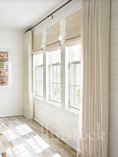 curtains for 3 windows in a row stock image of a row of three windows on a white wall with