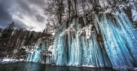 frozen waterfalls plitvice s frozen waterfalls are a spectacular sight in the depths of croatia s winter mirror