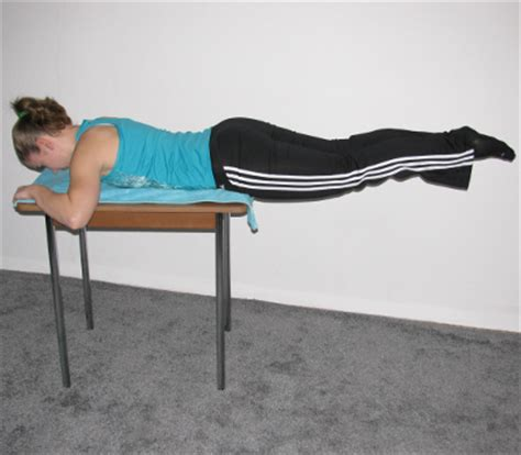 hyperextensions without bench reverse hyperextension on table form muscles worked benefits
