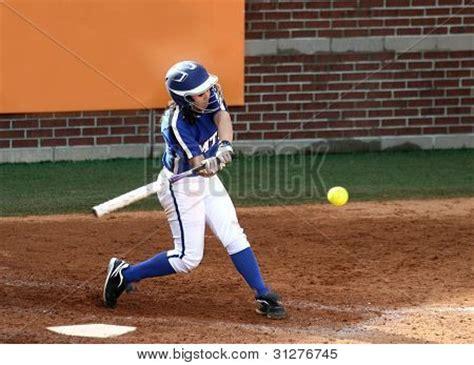 slow pitch swing college softball player swinging stock photo stock