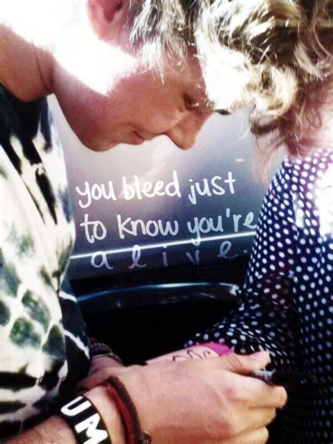 tattoo goo target ashton irwin drawing a butterfly on a fan s scars and cuts