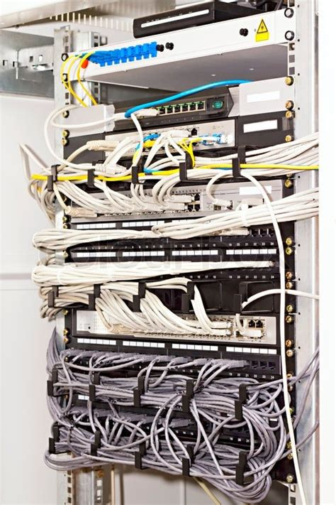 Inter Rack Cabling by Patch Panel Server Rack With Cords In Different Colors
