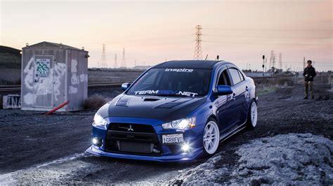 mitsubishi evo blue mitsubishi evo blue car lights drift 4k wallpaper 4k
