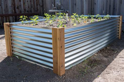 unique metal raised garden planter  cedar board base
