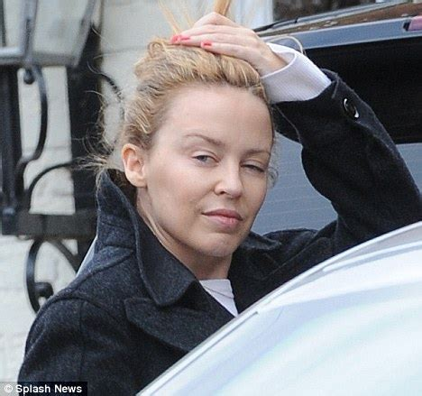 kylie minogue looks too tired to put on her make up as she