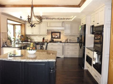traditional kitchen with 2 tone maple cabinets traditional