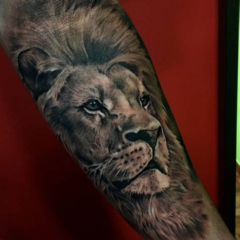 black and grey lion tattoos black and grey style on the forearm by sergio