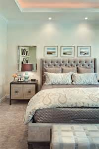 Master bedroom tray ceiling and framed art above bed home decorating