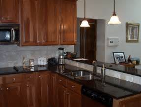 Granite With Cherry Cabinets In Kitchens Kitchen With Cherry Cabinets And Black Granite Flickr Photo