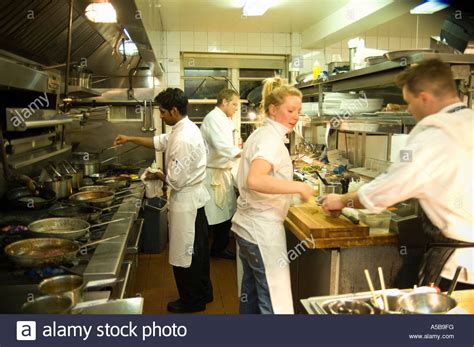 9 practical kitchen cleaning tips from a busy mom team of restaurant kitchen staff busy at work stock photo