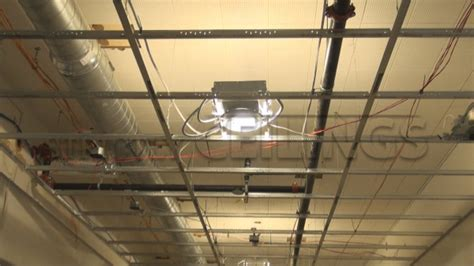 Installing Can Lights In Drop Ceiling Drywall Suspended Grid Showroom Drywall Suspended Ceiling Grid Systems How To Install