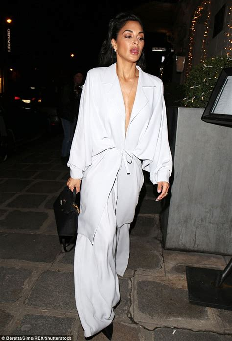 Fashion Week 101 What Does A Dresser Do by Scherzinger Dazzles In A Plunging White Jumpsuit