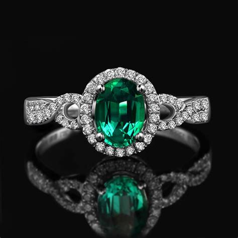 1 carat emerald and halo engagement ring in white