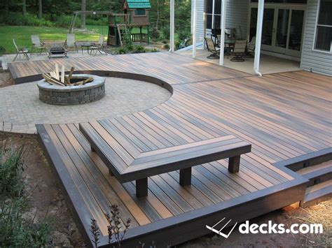 diy pit wood deck low profile composite deck surrounding a circular paver pit deck benches decks