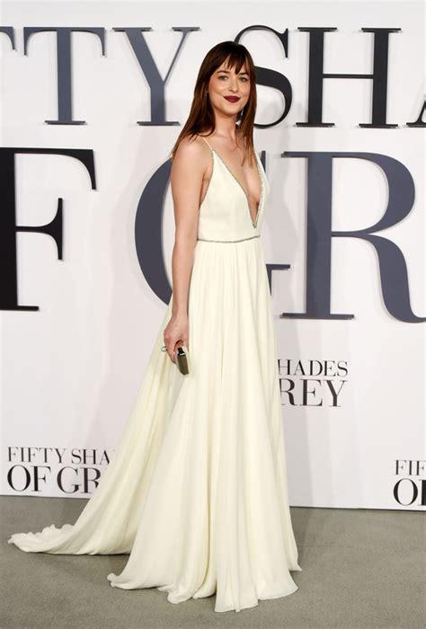 film fifty shades of grey premiera dakota johnson takes the plunge in daring white dress for
