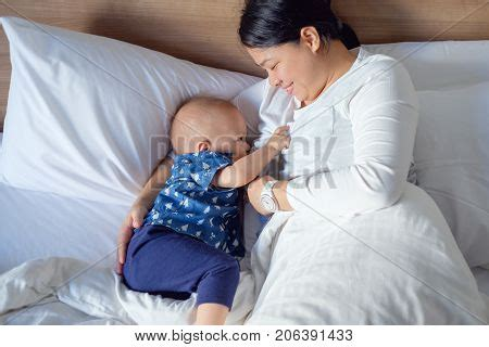 asian mother and son bedroom portrait stock photo getty japanese mom son images illustrations vectors japanese